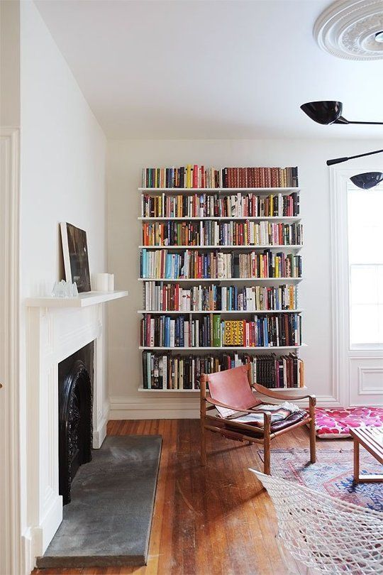 Track shelves are versatile open shelving for library wall | Girlfriend is Better