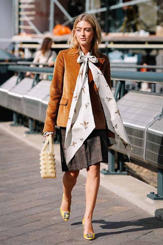 Corduroy blazer with pussy bow tie, plaid skirt, and straw purse | Girlfriend is Better