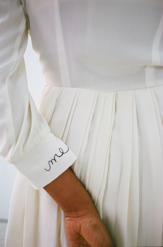 Me embroidered lettering on sleeve cuff of all-white dress | Girlfriend is better
