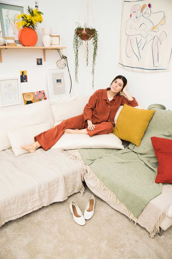 Orange pant suit leisure in plant-filled home | Girlfriend is Better