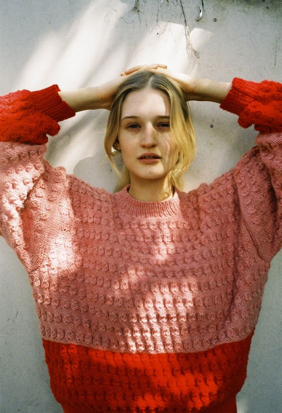 Block shades of orange in cable knit sweater | Girlfriend is Better