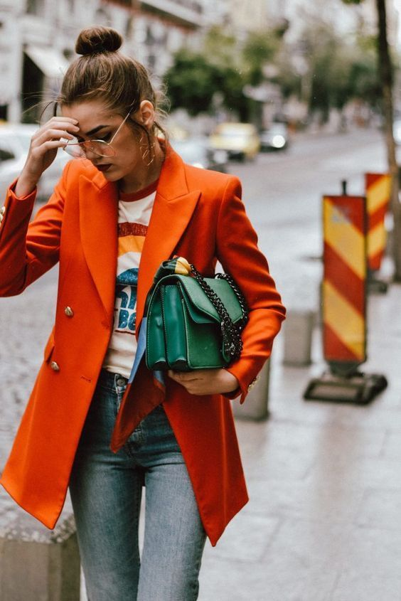 Orange pea coat with green bag and graphic rainbow tee | Girlfriend is Better