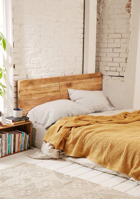 Earth element Feng Shui | yellow bedding, brick walls | Girlfriend is Better