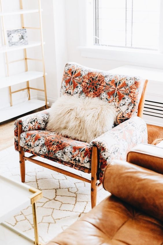 Taurus astrology home decor guide | Mid-century modern chair and leather sofa | Girlfriend is Better