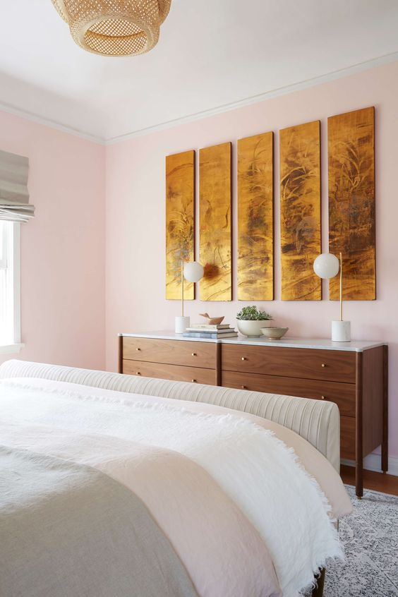 Leo astrology home decor guide | pink bedroom mid-century modern dresser gold wall art panels | Girlfriend is Better
