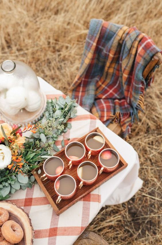 Fall Hygge outdoor tablescape apple cider blanket | Girlfriend is Better