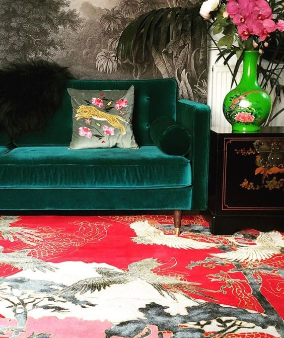 jungle decor red Asian rug green velvet sofa | Girlfriend is Better