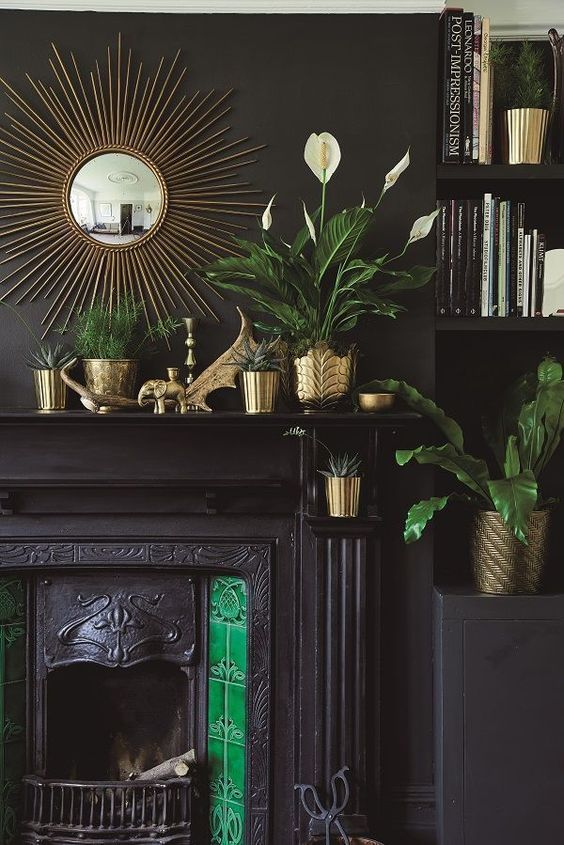 metal element Feng Shui | mid-century modern gold vases plant pottery starburst mirror black fireplace | Girlfriend is Better
