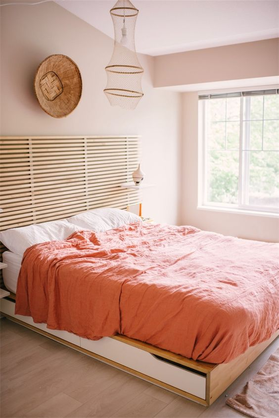 Pink Walls | Beach decor pink bedroom natural wood platform bed linen bedding | Girlfriend is Better