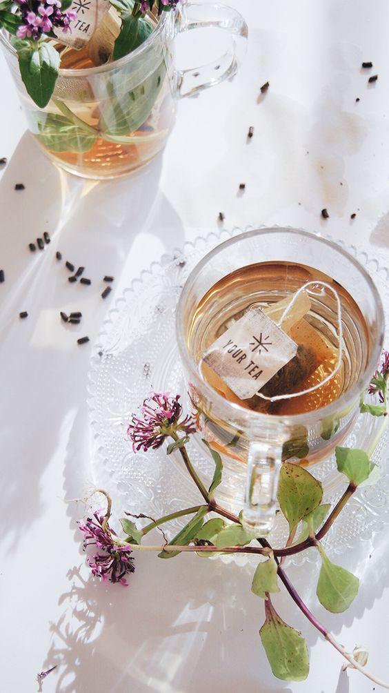 Afternoon Tea | flowers in filled teacup on wood slab | Girlfriend is Better