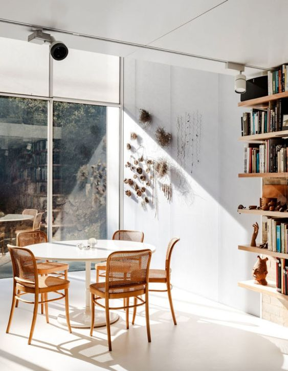 caned chairs | light minimalist seats open shelving dining room | Girlfriend is Better