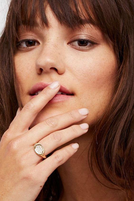 gold signet ring | woman playing with mouth  | Girlfriend Is Better