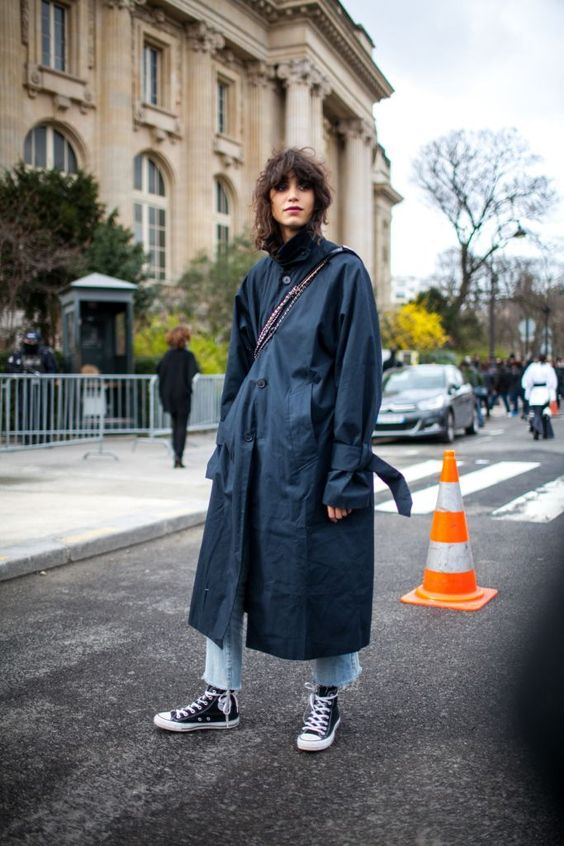 tomboy fashion | black trench coat curly bob hair style high-water jeans Converse | Girlfriend is Better
