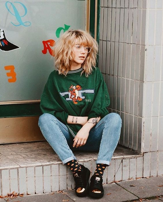 tomboy fashion | vintage green Tigger sweatshirt high-water jeans black tennis shoes | Girlfriend is Better