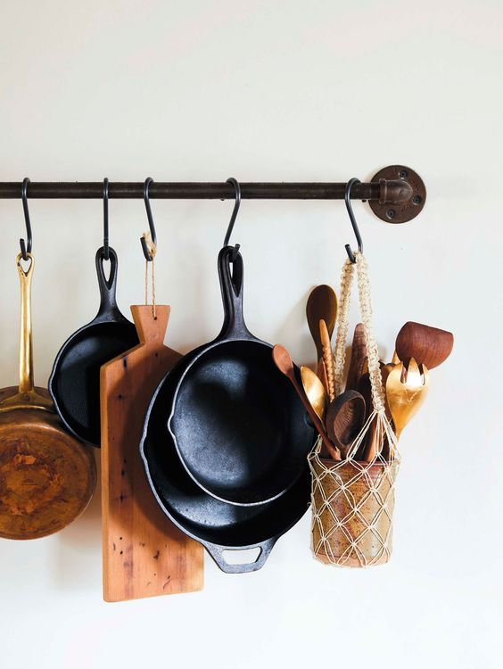 midsummer hygge | pot rack cheeseboard cutting board skillets macrame wood spoons | Girlfriend is Better