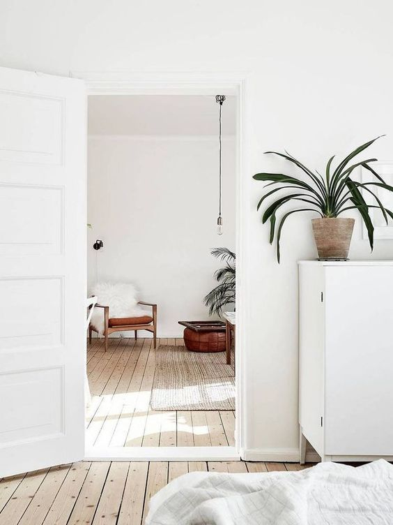 white interiors | minimalism living room mid-century modern plant chair natural textiles | Girlfriend is Better