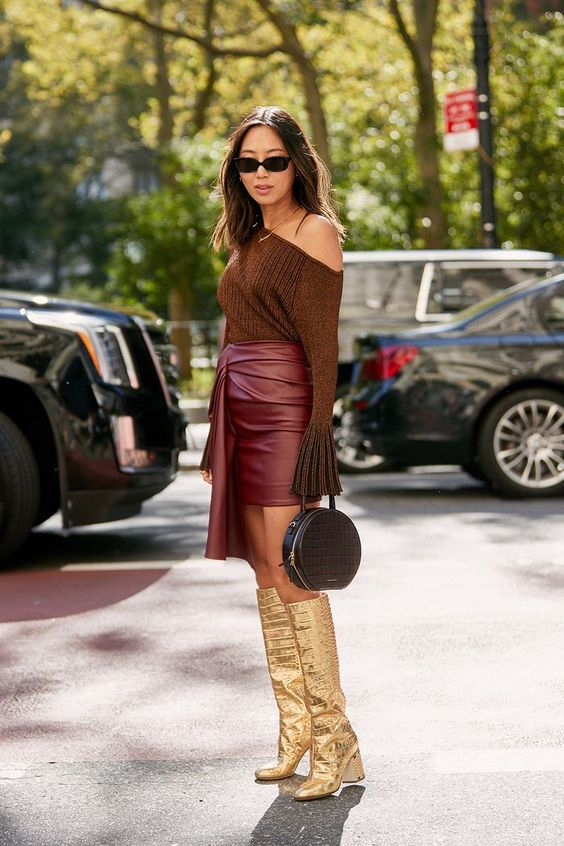 gold boots | knee high leather skirt monochromatic top handle purse | Girlfriend is Better