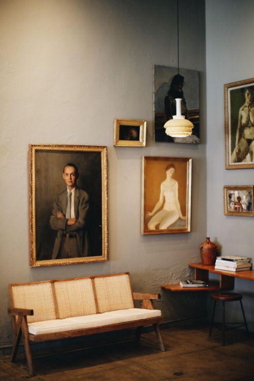 displaying art | gallery wall staggered paintings random people corner living room | Girlfriend is Better