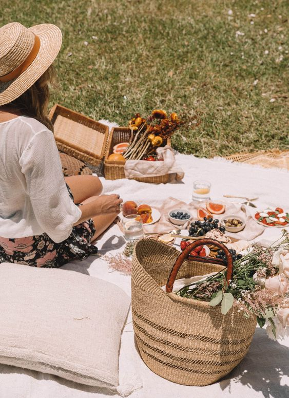 Spring picnic | straw basket fruit blanket pillow wildflowers hygge | Girlfriend is Better
