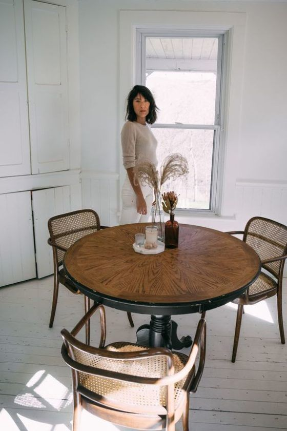 hygge tablescapes   caned chairs amber glass bottle candles   Girlfriend is Better