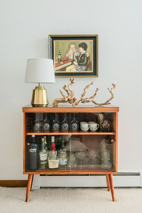 bar cart styling | mid-century modern cabinet liquor painting crystal glassware china tea cups | Girlfriend is Better
