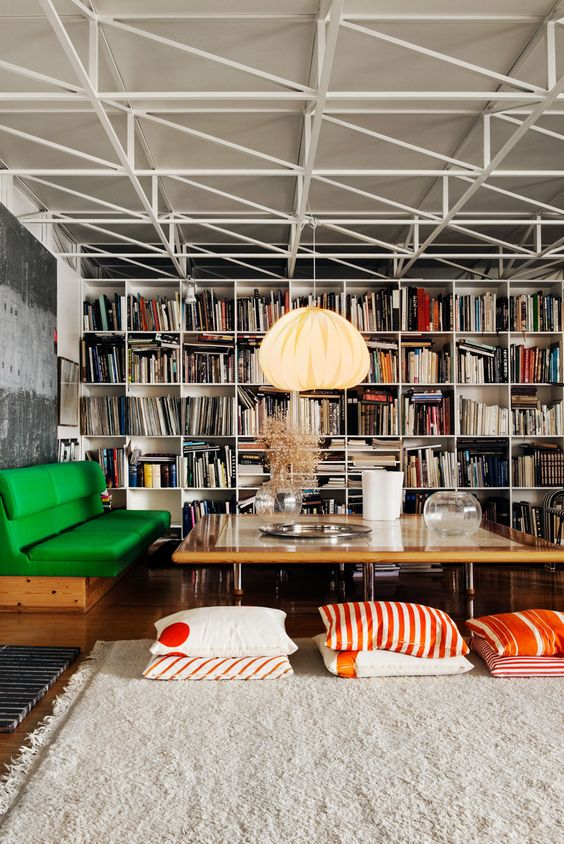 bench seating | home library green cushions coffee table book shelves floor pillows | Girlfriend is Better