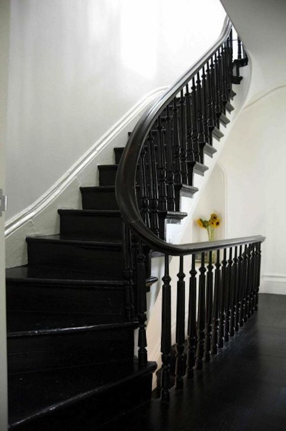 black floors | curved staircase bannister wood flooring stair risers | Girlfriend is Better