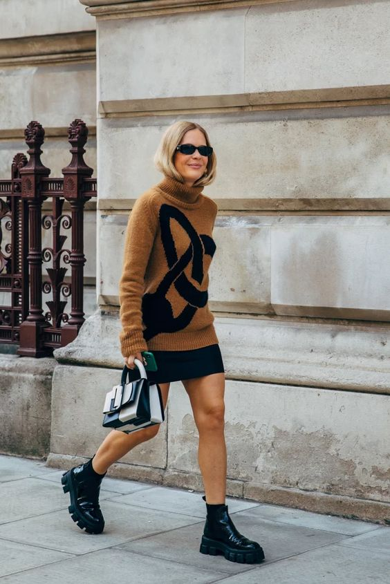 chunky black boots | winter fashion street style turtleneck sweater mini skirt top handle purse | Girlfriend is Better