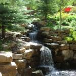 Alt text: 113 Highlands Way 15 foot waterfall