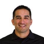 Headshot of Manny Diaz.
