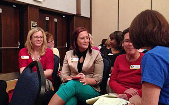 Group of woman sitting and chatting during an activity led by Keynote Speaker Vicki Hitzges