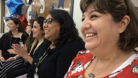 Women listen to Keynote Speaker Vicki Hitzges and smile and laugh
