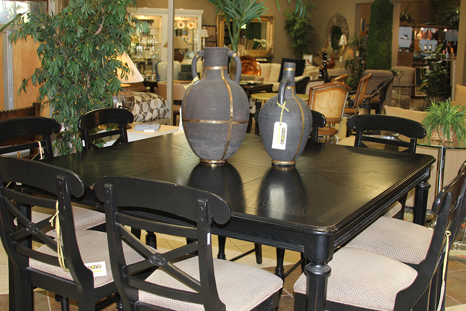 Black Wooden Dining Chairs with Upholstered Seats Around a Square Table