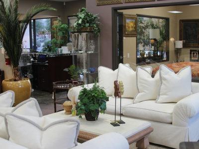Pair of White Sofas Around a White Marble Coffee Table