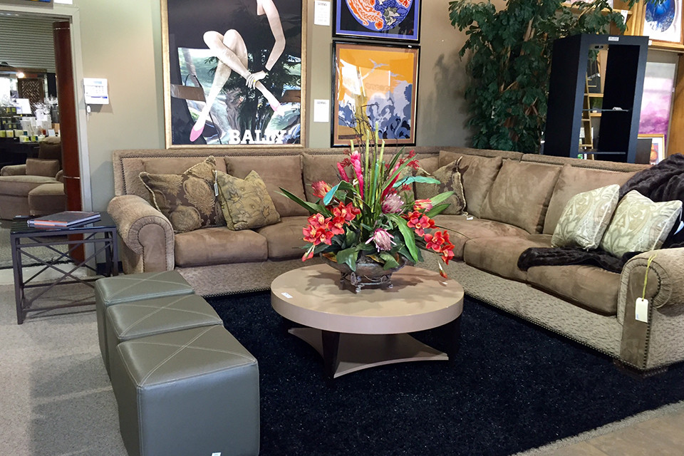Short Round Chunky Coffee Table with Large Flower Arrangement