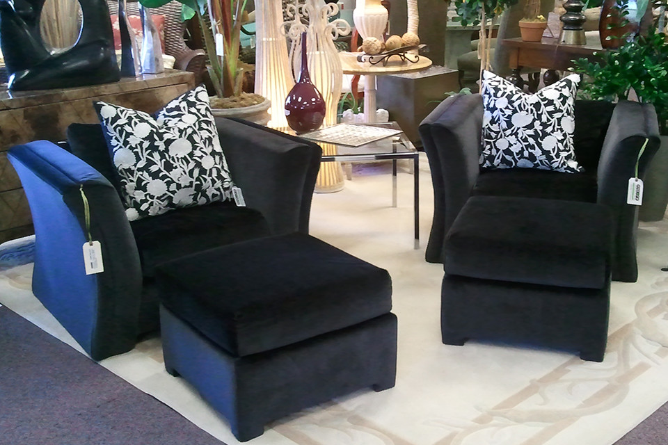 Two Black Love Seats with Matching Ottomans
