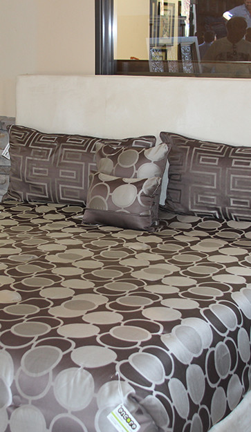 Bed with Comforter of Gray Circles
