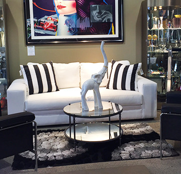 White Couch with Black and White pillows and Large elephant statue