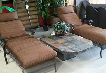 Brown lounge chairs and Stone table