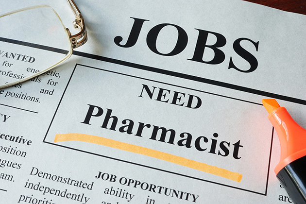 Newspaper with ads for vacancy pharmacist.