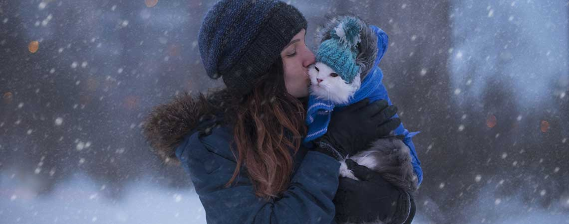 Girl with Cat in the Snow