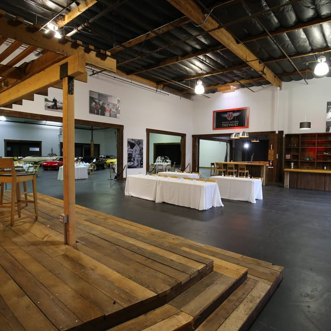 Open indoor event space with a stage, sd creative space.