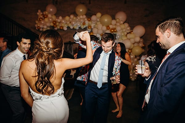 bride and groom dancing, cater weddings and events | snake oil cocktail co.