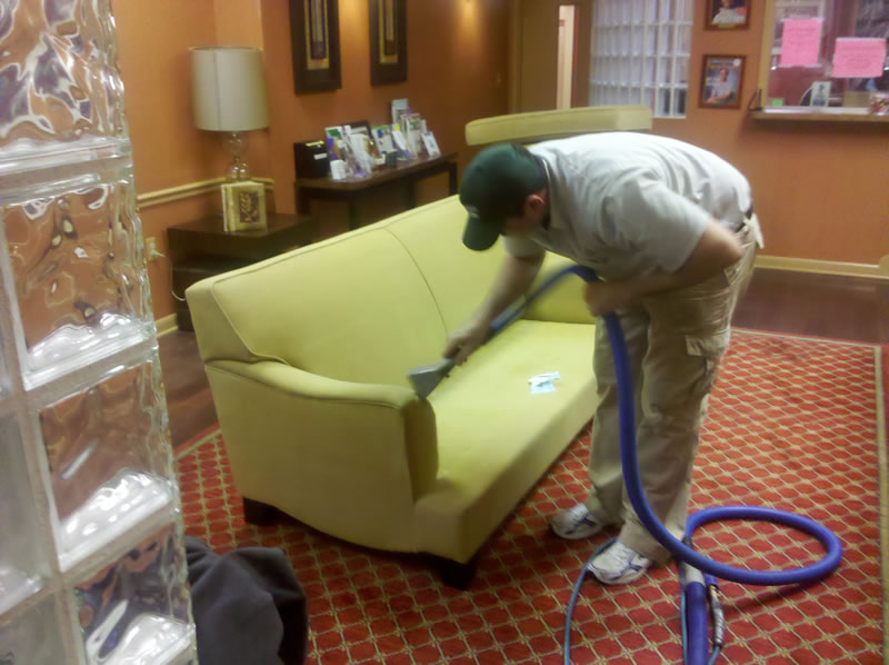 PROFESSIONAL CLEANER REMOVING STAINS FROM CARPET AND UPHOLSTERY