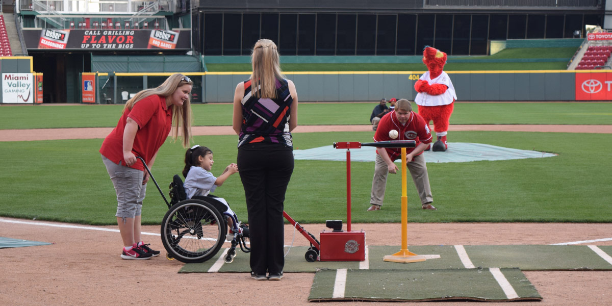 Child up to bat at May We Help Legendary Leadership Gala 2016