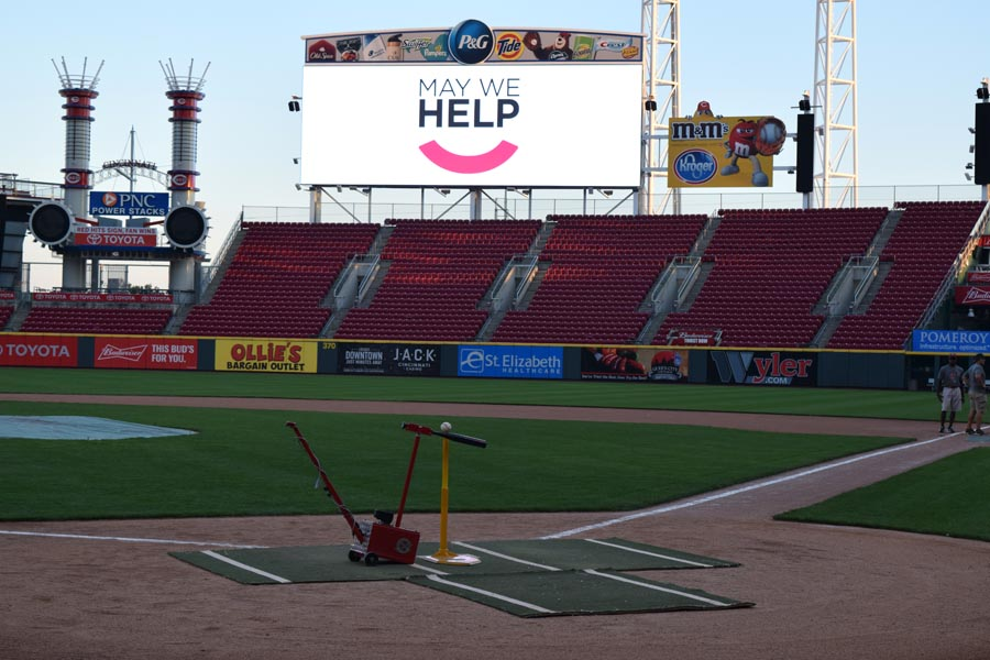 Batter up machine on the field at Great American Ballpark