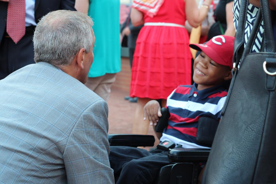 Thom Brennaman greeting one of the smiling children
