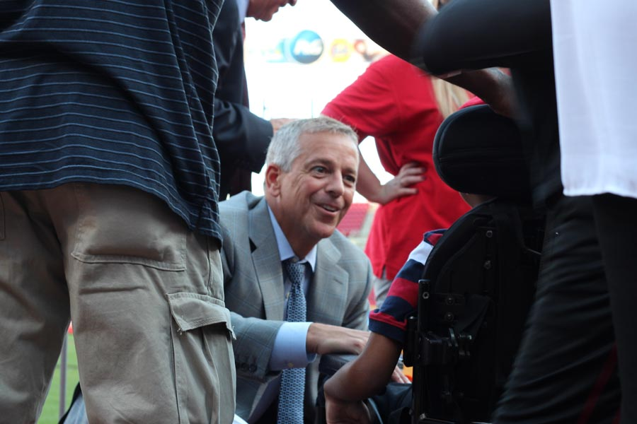 Thom Brennaman greeting one of the children at May We Help Leadership Gala 2016