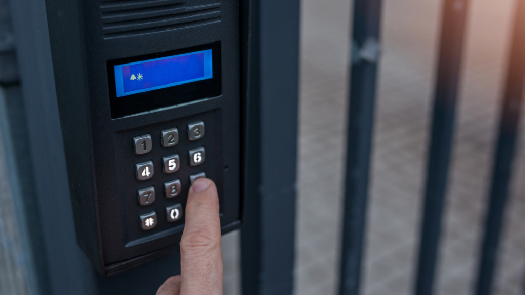 typing on gate keypad | 24-hour gate repairs