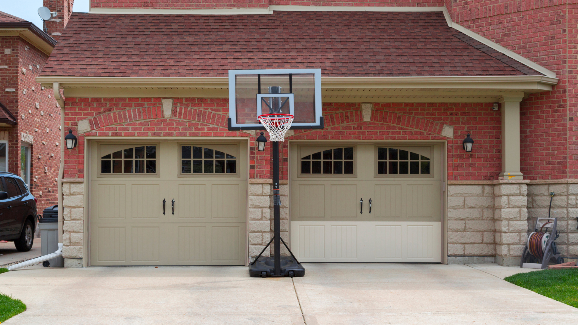 two-car garage with basketball hoop